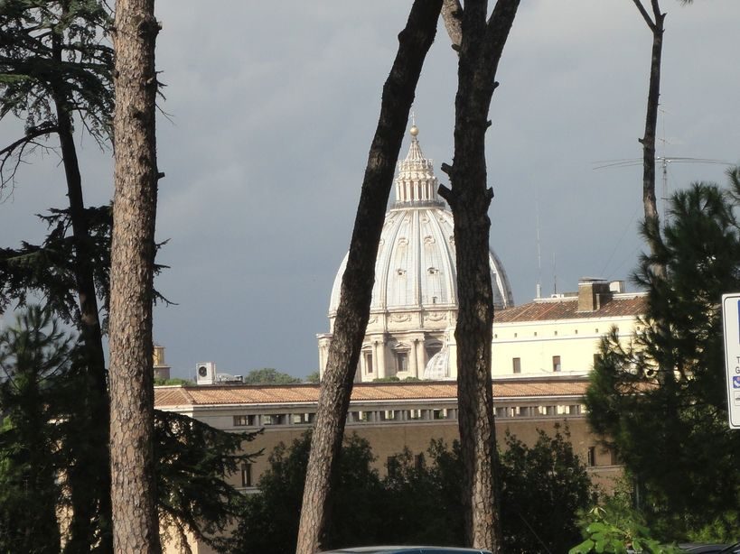 Behind the trees. St. Peter's Basilica. From Gianicolo Hill, Rome, Italy