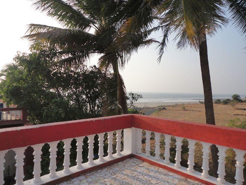 The road, the sand, the sea. Karde, Maharashtra, India