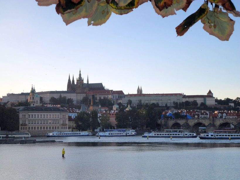 Ferry me! Vltava River and the Prague Castle. Prague, Czech Republic.