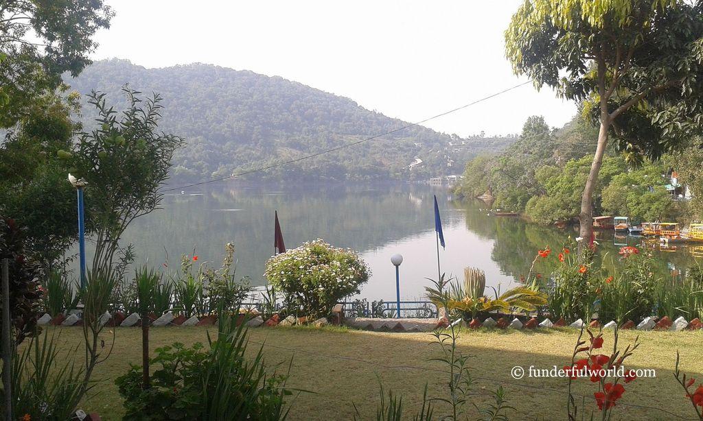A garden and a lake beyond. Naukuchiatal, Uttarakhand, India.