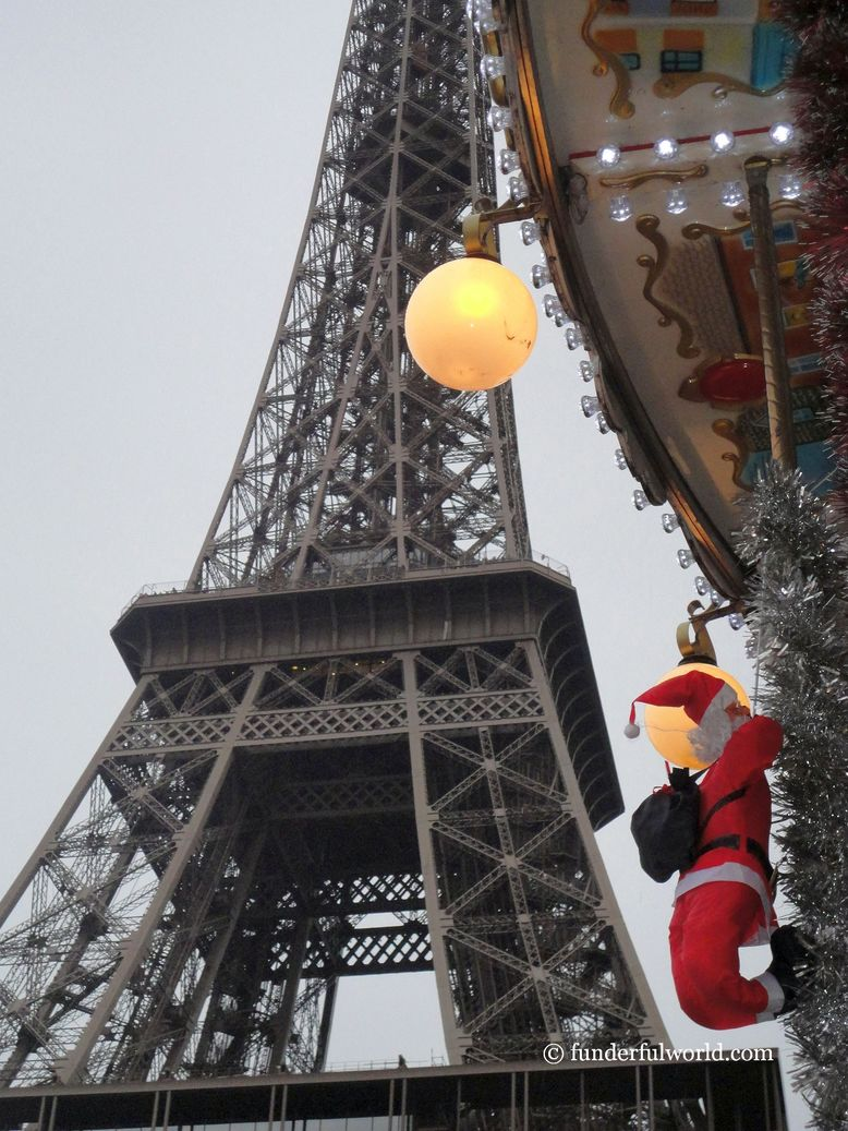 On a mission. Santa Claus at the Eiffel Tower, Paris, France.