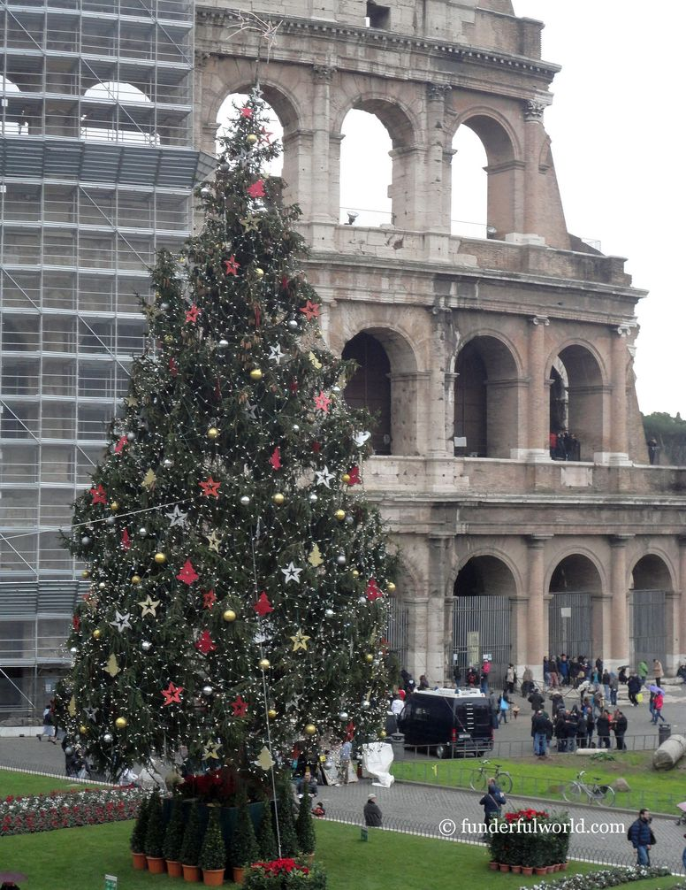 Celebrating the old. Xmas tree at the Colosseum, Rome, Italy.